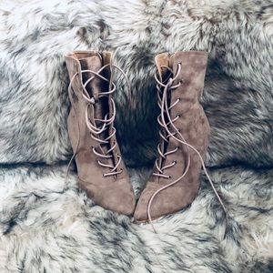 Tan suede lace up, heeled boot.